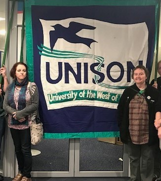 Rhiannon Davies(left) and Helen Hopwood with the branch banner